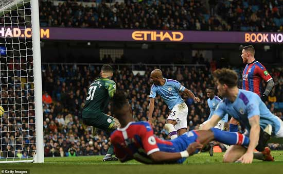 Fernandinho (25) of Manchester City scores an own goal which brings Crystal Palace level late on during Saturday's game.