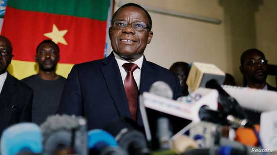FILE - Maurice Kamto, a presidential candidate of Renaissance Movement (MRC), holds a news conference at his headquarter in Yaounde, Cameroon, Oct. 8, 2018.