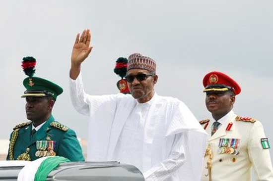 Nigerian President Muhammadu Buhari waves at the crowd during a celebration ceremony marking Democracy Day in Abuja, Nigeria June 12, 2019. File image