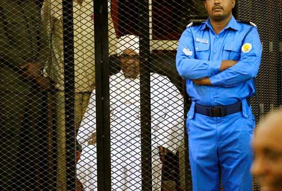 Former Sudanese president Omar Hassan al-Bashir sits inside a cage during the hearing of the verdict that convicted him of corruption charges in a court in Khartoum, Sudan. December 14, 2019. Reuters/Mohamed Nureldin Abdallah