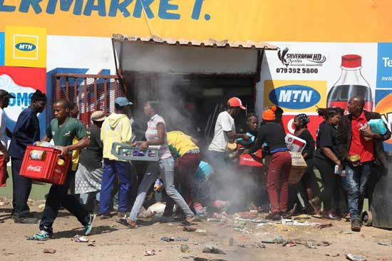 File image: Looting and violence erupt in shops owned by foreign nationals in Soweto, Johannesburg. Credit - theconversation