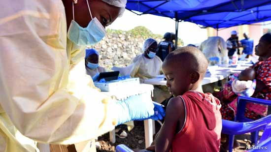 A Congolese health worker administers ebola vaccine to a child at the Himbi Health Center in Goma, July 17, 2019.