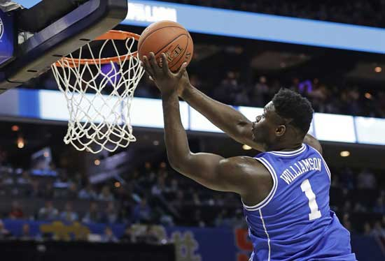 Duke's Zion Williamson (1) drives to the basket against North Carolina during the first half of an NCAA college basketball game in the Atlantic Coast Conference tournament in Charlotte, N.C., Friday, March 15, 2019. (AP Photo/Chuck Burton)