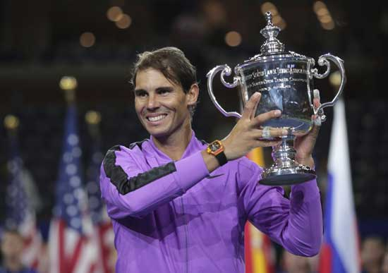 Rafael Nadal, of Spain, holds up the championship trophy after defeating Daniil Medvedev, of Russia, to win the men's singles final of the U.S. Open tennis championships Sunday, Sept. 8, 2019, in New York. (AP Photo/Charles Krupa)