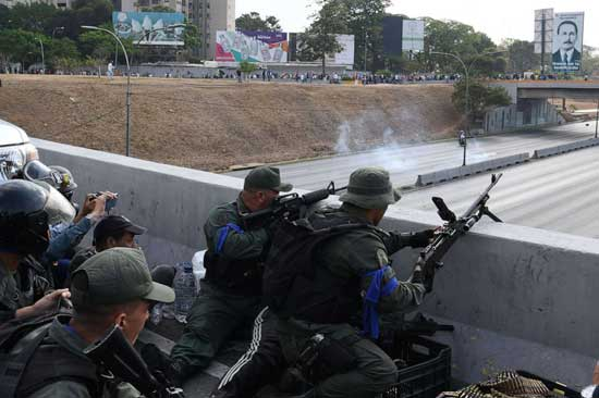 Soldiers loyal to Venezuelan opposition leader and self-proclaimed acting president Juan Guaido take position in front of La Carlota base in Caracas, April 29, 2019.