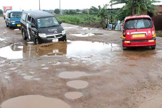 Bad Roads In Ghana: Queenmother of Adusah Ototsem Angre at Ga West 'Killer' Roads. Image credit - graphiconline