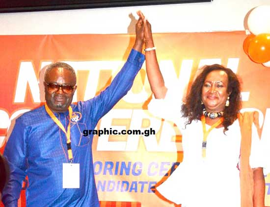 Mr Kofi Akpaloo (left), the presidential candidate of the Liberal Party of Ghana, introducing Mrs Margaret Obrian Sarfo (right), his running mate, at the party's national conference in Accra