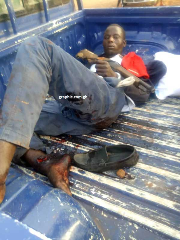 Seidu Salifu, 25, lies in the back of a police truck after his arrest.