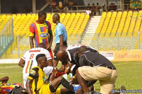 In this undated image, Sporting Mirren's Festus Nutakor (Black & yellow jersey) receives medical attention during an MTN FA Cup match against Accra Hearts of Oak.  Image credit - @heartsofoak.com