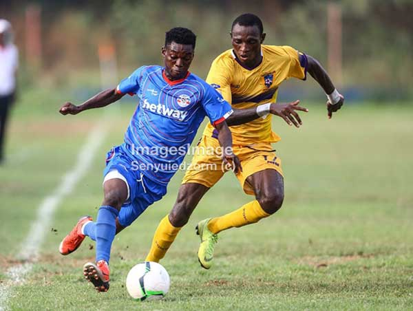A Medeama SC player (yellow and mauve) and a Liberty Profs player fight for the ball in their Ghana Premier League Week 03 encounter played at Dansoman's Carl Reindorf Park on January 11th 2020. Image credit – Images_image